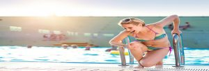 Young woman with injured leg. Swimming pool injury claims are an area of law we specialise in at The Compensation Experts.
