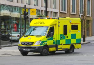 London Emergency Ambulance on a road during the day