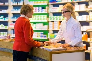 Customer Receiving Medication From Pharmacist