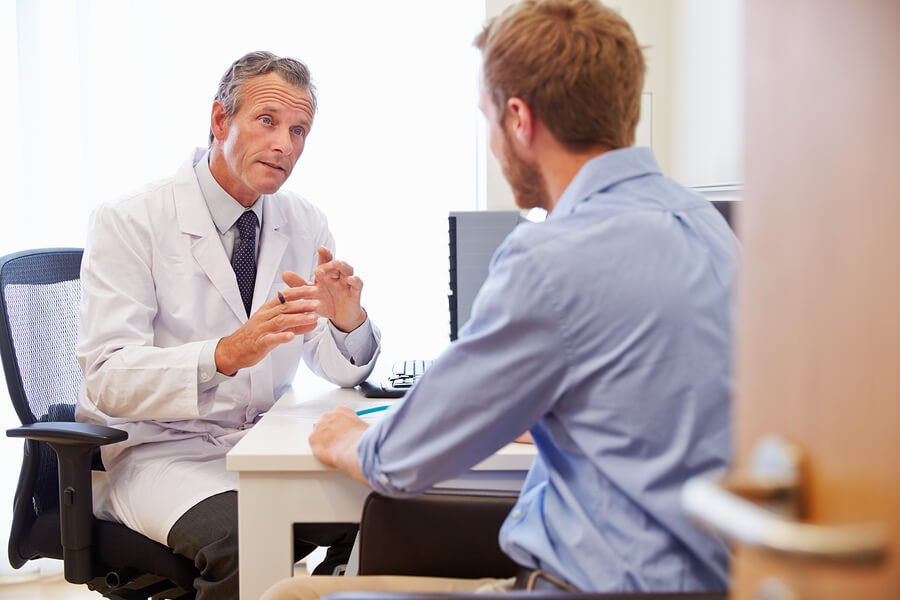 Male Patient Consultation for holiday illness claims.