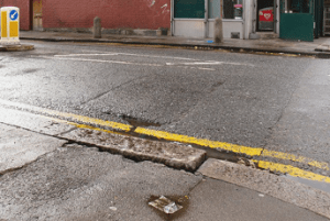 Cracked Roads can lead to pavement trip compensation claims.