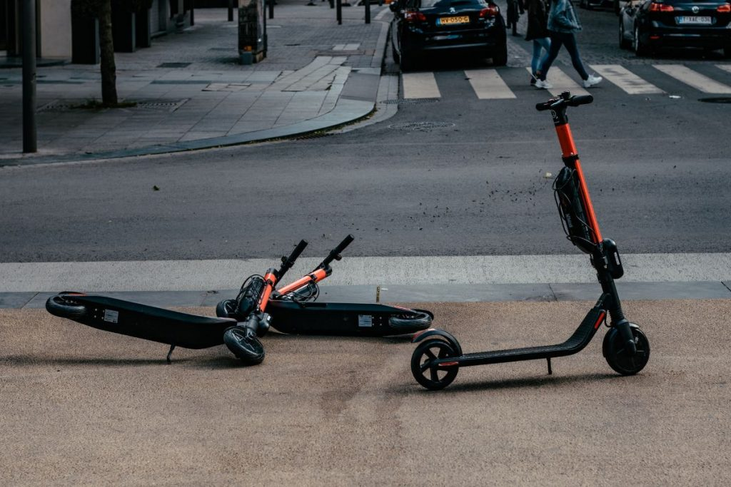 An e-scooter left on the street as part of a public trial.